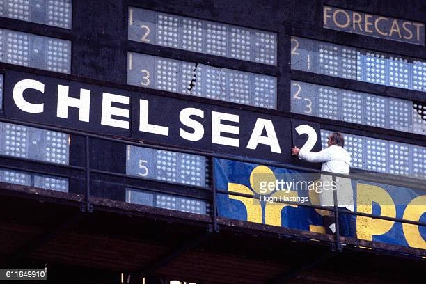 The Wembley ground staff signal Chelsea's second goal on the stadium scoreboard