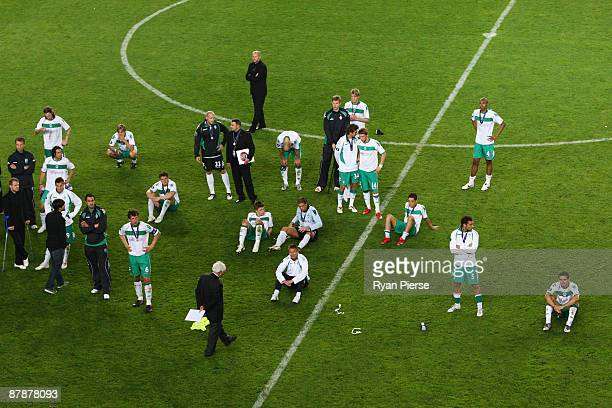The Werder Bremen look on dejectedly following their team's defeat after extra time at the end of the UEFA Cup Final between Shakhtar Donetsk and...