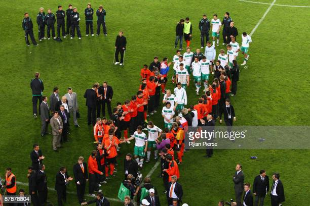The Werder Bremen players are appluaded by the Shakhtar Donetsk players as they go to collect their loser's medals following their team's defeat...