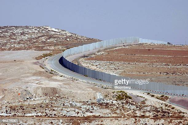 The West Bank barrier is viewed from a hill in the Judean desert in Israel on Sunday Oct 21 2007 Israel constructed the barrier which separates...