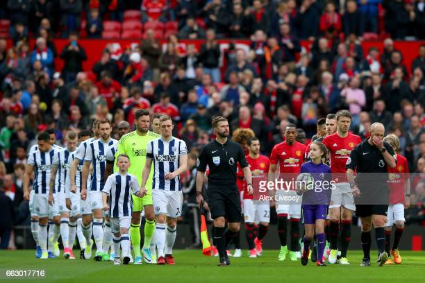 The West Bromwich Albion and Manchester United team walk out prior to kick off during the Premier League match between Manchester United and West...