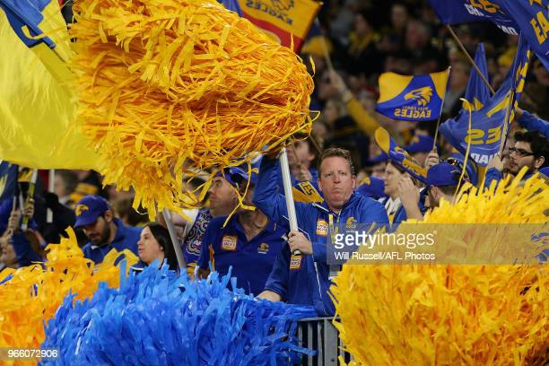The West Coast cheer squad celebrate a goal during the round 11 AFL match between the West Coast Eagles and the St Kilda Saints at Optus Stadium on...