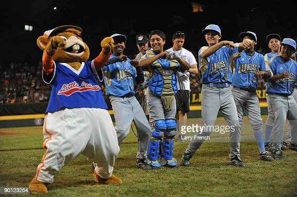 The West dances with the Little League mascot Dugout before the game against the Southeast in the US semifinal at Lamade Stadium on August 27 2009 in...