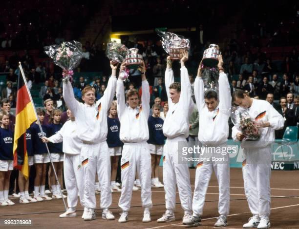The West German Davis Cup team Boris Becker, Eric Jelen, Patrik Kuhnen, Carl-Uwe Steeb and Niki Pilic lift their trophies after defeating Sweden in...