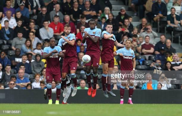 The West Ham defensive wall Carlos Sanchez Andriy Yarmolenko Issa Diop Declan Rice and Javier Hernandez during the PreSeason Friendly match between...