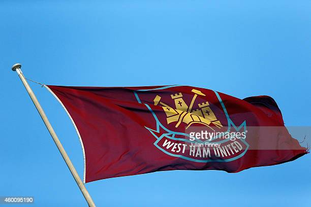 The West Ham flag flies ahead of the Barclays Premier League match between West Ham United and Swansea City at Boleyn Ground on December 7 2014 in...