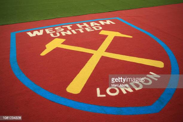 The West Ham logo is seen next to the pitch prior to the Premier League match between West Ham United and Arsenal FC at London Stadium on January 12...