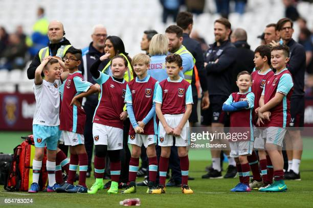 The West Ham mascots watch the team warm up prior to the Premier League match between West Ham United and Leicester City at London Stadium on March...