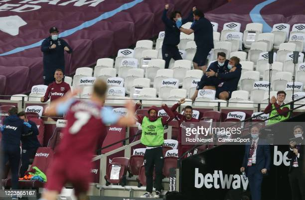 The West Ham United bench celebrate Andriy Yarmolenkos winning goal during the Premier League match between West Ham United and Chelsea FC at London...