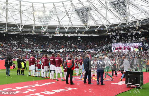 The West Ham United player create a guard of honor for the Manchester City team prior to the Premier League match between West Ham United and...