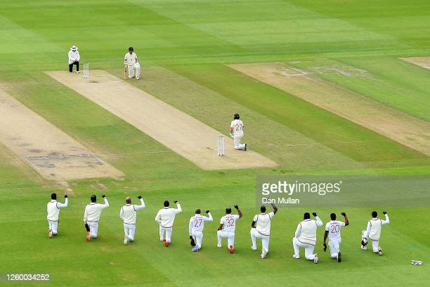 The West Indies and England players take a knee in support of Black Lives Matter ahead of the first ball during day one of the Ruth Strauss...