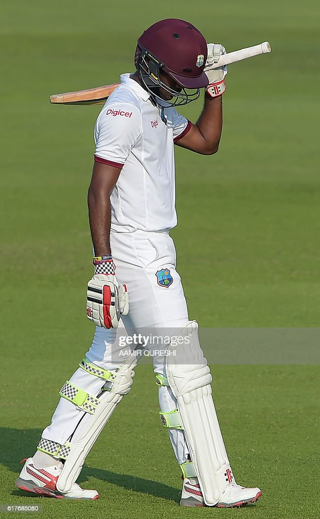 The West Indies' batsman Kraigg Brathwaite reacts as he leaves the ground after his dismissal on the fourth day of the second Test between Pakistan and the the West Indies at the Sheikh Zayed Cricket Stadium in Abu Dhabi on October 24, 2016. Pakistan pressed West Indies hard for a series-clinching win in the second Test after setting a daunting 456-run target on the fourth day in Abu Dhabi. By close of play Pakistan had taken four wickets at 171 leaving the West Indies to bat out the fifth and final day on October 25 or score a further 285 runs with six wickets intact for an unlikely win. / AFP / AAMIR