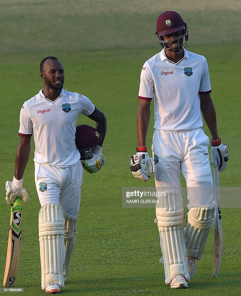 The West Indies' batsmen Jermaine Blackwood (L) and Roston Chase back to pavilion at the end of the fourth day of the second Test between Pakistan and the West Indies at the Sheikh Zayed Cricket Stadium in Abu Dhabi on October 24, 2016. Pakistan pressed West Indies hard for a series-clinching win in the second Test after setting a daunting 456-run target on the fourth day in Abu Dhabi. By close of play Pakistan had taken four wickets at 171 leaving the West Indies to bat out the fifth and final day on October 25 or score a further 285 runs with six wickets intact for an unlikely win. / AFP / AAMIR