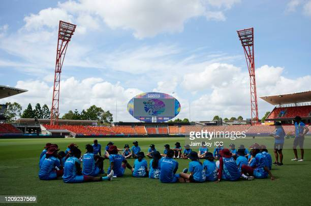 The West Indies Cricket team and the participants sit together during the ICC Women's T20 Cricket World Cup Cricket 4 Good Clinic at the Sydney...