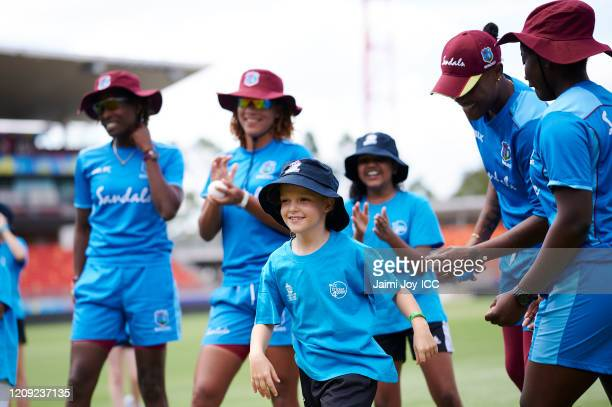 The West Indies Cricket team interact with the girls participating during the ICC Women's T20 Cricket World Cup Cricket 4 Good Clinic at the Sydney...