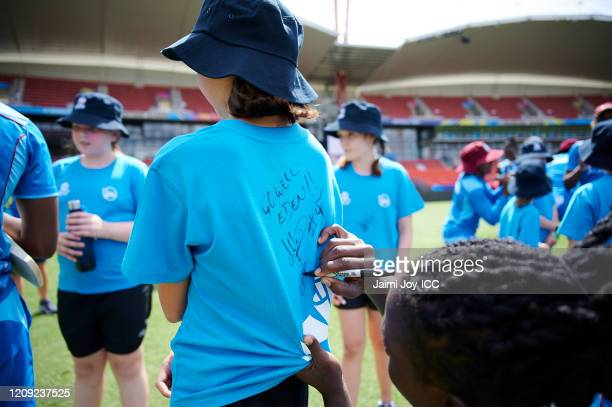 The West Indies Cricket team sign the shirts of the young participants during the ICC Women's T20 Cricket World Cup Cricket 4 Good Clinic at the...