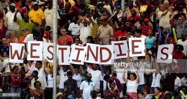 The West Indies fans celebrate a 6 during the ICC Cricket World Cup match at the Kensington Oval Bridgetown Barbados