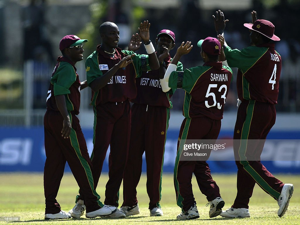 The West Indies players celebrate a wicket : News Photo