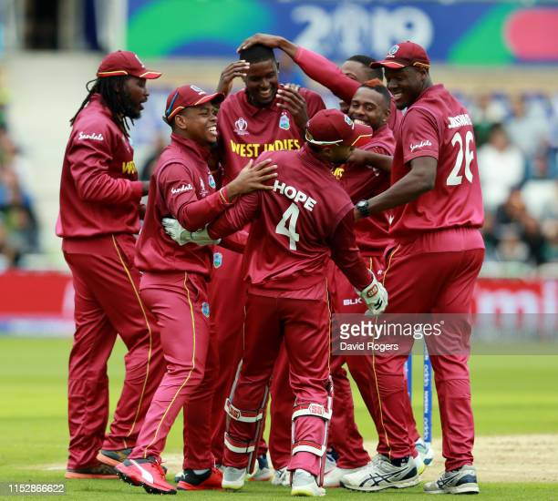The West Indies players celebrate after Jason Holder takes the wicket of Sarfaraz Ahmed during the Group Stage match of the ICC Cricket World Cup...