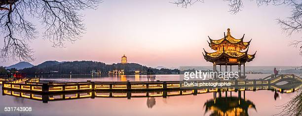 the west lake of hangzhou - hangzhou stock photos and pictures