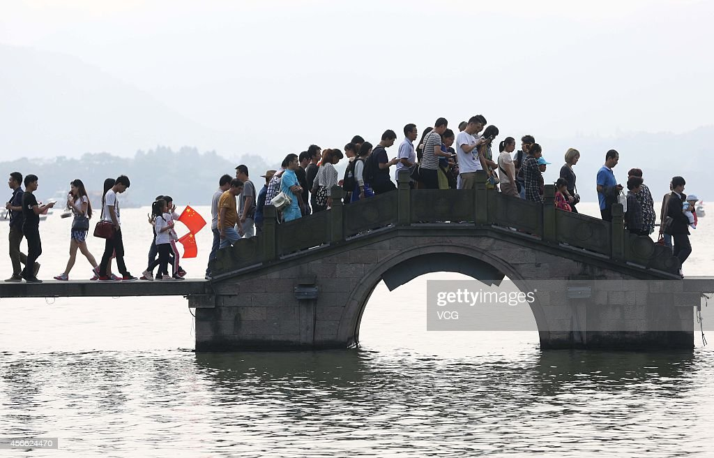 The West Lake Scenic Area is crammed with tourists on the third day of the National Day holiday on Ocober 3, 2014 in Hangzhou, China. China's golden-week National Day holiday is expected to bring a tourism peak throughout the country.
