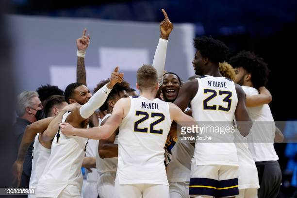 The West Virginia Mountaineers celebrate after their win in the first round of the 2021 NCAA Men's Basketball Tournament against the Morehead State...