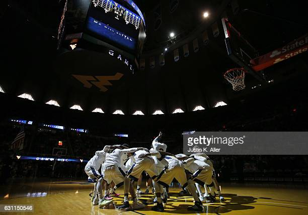 The West Virginia Mountaineers huddle before the game against the TCU Horned Frogs at the WVU Coliseum on January 7 2017 in Morgantown West Virginia