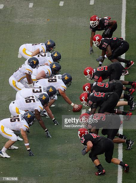 The West Virginia Mountaineers offensive lines up with the ball against the Rutgers University Scarlett Knights defensive line on October 27, 2007 at...
