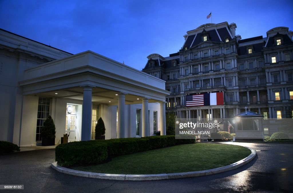 The West Wing Of White House L And Eisenhower Executive Office Building R With US French National Flags Are Seen During A State Dinner