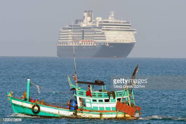 The Westerdam cruise ship is seen past a fishing vessel as it approaches port in Sihanoukville Cambodia's southern coast on February 13 where the...