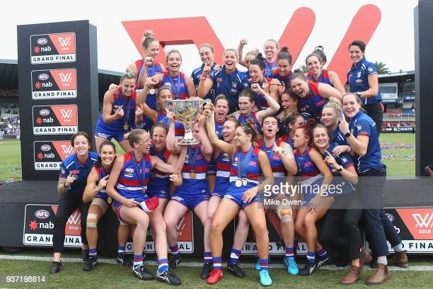 The Western Bulldogs team pose after winning the AFLW Grand Final match between the Western Bulldogs and the Brisbane Lions at Ikon Park on March 24...