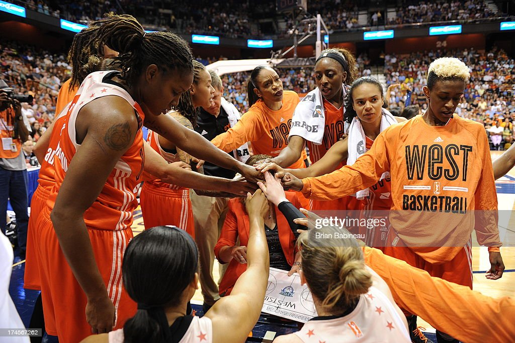 The Western Conference All-Stars huddle during a timeout during the 2013 Boost Mobile WNBA All-Star Game on July 27, 2013 at Mohegan Sun Arena in Uncasville, Connecticut.