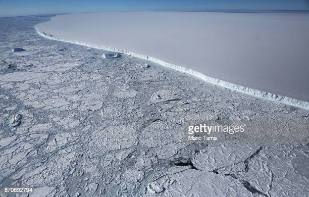 The western edge of the famed iceberg A-68 , calved from the Larsen C ice shelf, is seen from NASA's Operation IceBridge research aircraft, near the...