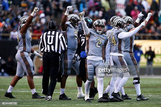 The Western Michigan Broncos celebrate after forcing a fourth down against the Buffalo Bulls at Waldo Stadium on November 19, 2016 in Kalamazoo,...