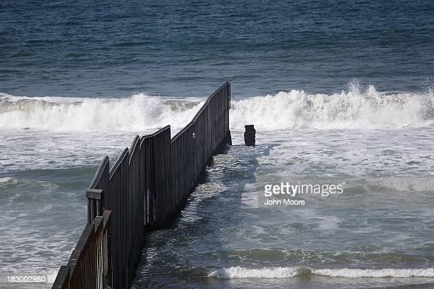 The western most tip of USMexico border fence stretches into the Pacific Ocean on October 3 2013 in San Diego California While hundreds of thousands...