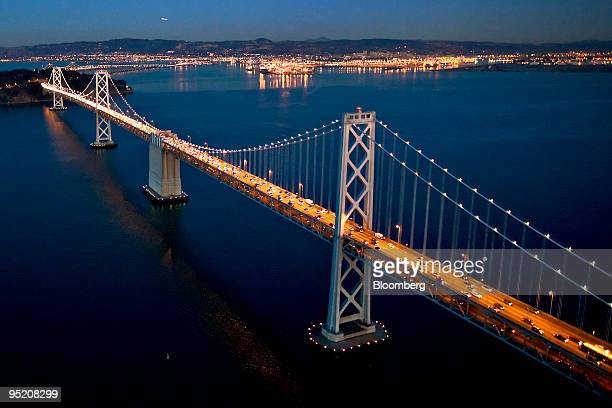 The western span of the San FranciscoOakland Bay Bridge extends to Treasure Island from San Francisco California US as seen in this aerial photo...