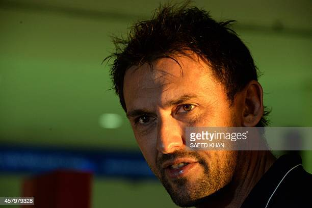 The Western Sydney Wanderers' coach Tony Popovic speaks with the media prior to the team's departure for Saudi Arabia at Sydney International Airport...