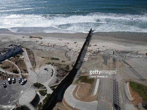 The western terminus of the US / Mexico border Mexico on the left the United States on the right Pacific Ocean on the top I used a kite to fly the...