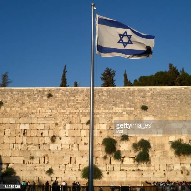 "The Western Wall, aka Wailing Wall in Jerusalem, Israel and the israeli flag. Le Mur Occidental dit ""Mur des Lamentations"" à Jérusalem, Israël, et le..."