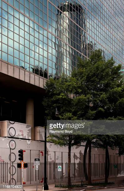 The Westin Peachtree Plaza Atlanta is reflected off the American Cancer Society building in Atlanta, Georgia on July 28, 2019.