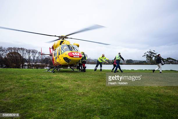 The Westpac rescue helicopter assists with the evacuation of residents after the Mersey River breaks its banks and floods several small towns cutting...