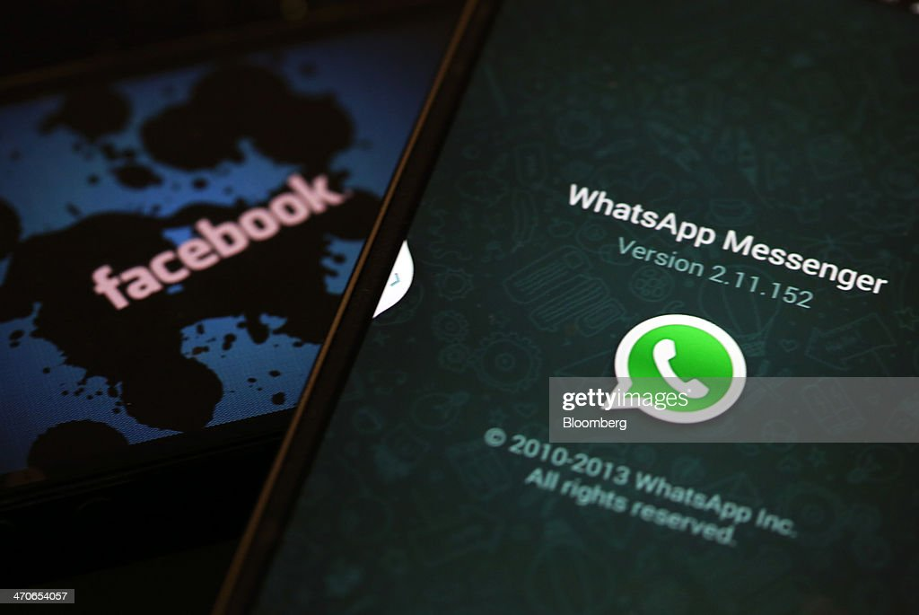 The WhatsApp Inc. mobile-messaging application WhatsApp and a Facebook Inc. logo are displayed on an the screens of mobile handsets in this arranged photograph taken in London, U.K., on Thursday, Feb. 20, 2014. Facebook, the worlds largest social network, agreed to acquire mobile-messaging startup WhatsApp Inc. for as much as $19 billion in cash and stock, seeking to expand its reach among users on mobile devices. Photographer: Chris Ratcliffe/Bloomberg via Getty Images