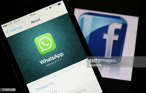 The WhatsApp Inc mobilemessaging application WhatsApp and the Facebook Inc logo are displayed on Apple Inc iPhones in this arranged photograph taken...