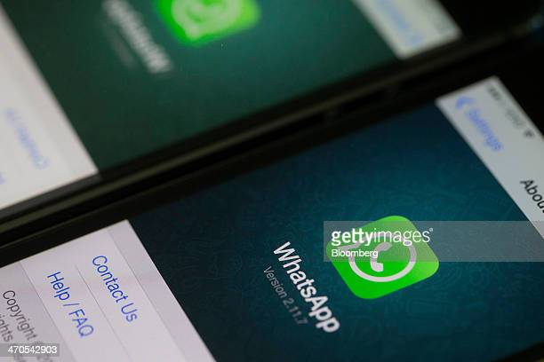 The WhatsApp Inc mobilemessaging application WhatsApp is displayed on an Apple Inc iPhone in this arranged photograph taken in Hong Kong China on...