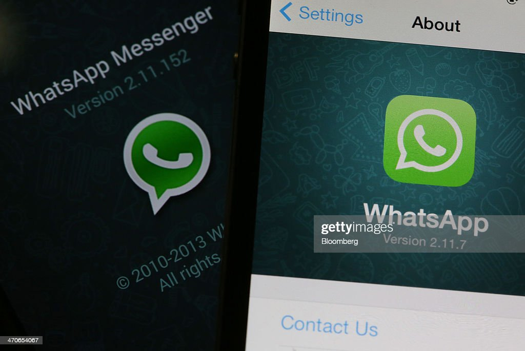 The WhatsApp Inc. mobile-messaging application WhatsApp is displayed on a Samsung Electronics Co. Galaxy S4 smartphone, left, and an Apple Inc. iPhone in this arranged photograph taken in London, U.K., on Thursday, Feb. 20, 2014. Facebook, the worlds largest social network, agreed to acquire mobile-messaging startup WhatsApp Inc. for as much as $19 billion in cash and stock, seeking to expand its reach among users on mobile devices. Photographer: Chris Ratcliffe/Bloomberg via Getty Images