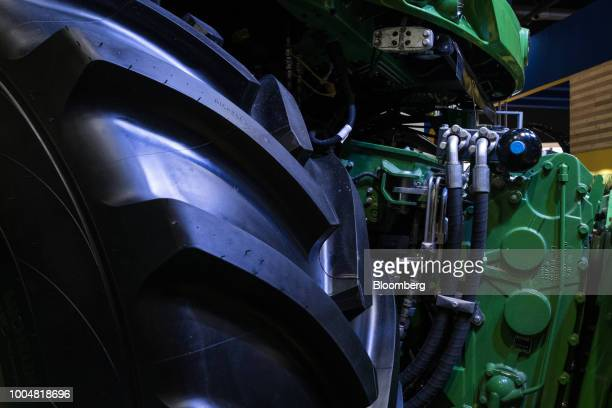 The wheel and engine of a Deere Co John Deere forage harvester is seen on display at the exhibition pavilion during La Exposicion Rural agricultural...