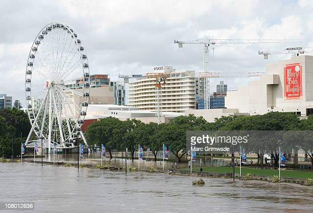 The Wheel at South Bank is seen partly submerged on January 13 2011 in Brisbane Australia The Brisbane river peaked at 446 metres today a metre less...