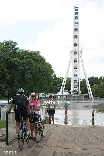 The Wheel at South Bank partly submerged on January 13 2011 in Brisbane Australia The Brisbane river peaked at 446 metres today a metre less than the...