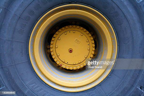 the wheel of a wheel loader - nut fastener stock photos and pictures