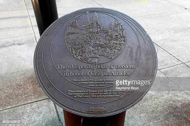 The 'Whispering Bells of Freedom honorary plaque dedicated to Crispus Attucks sits outside the outside The African American Museum In Philadelphia in...